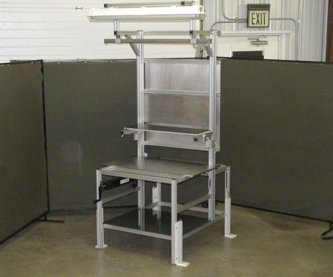 Complete.  Constructed of 40-4040-Lite, Overhead Trolly Rail, Hydraulic Lift, Al